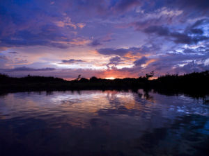 River at dusk, Malaysia, Kotakinabalu by Assaf Frank