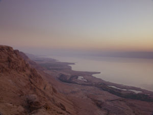 Sunrise above the dead sea from Dragot clifs with the view of the Jordan valley by Assaf Frank