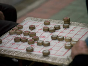 People playing game, close-up, South china by Assaf Frank