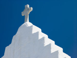 Mykonos,  Cyclades, Low angle view of church by Assaf Frank