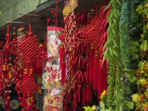 Chinese New Year Decorations in market, close-up by Assaf Frank