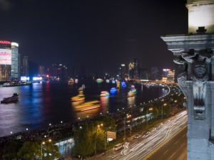 China, Shanghai, Boats in water at night (blurred motion) by Assaf Frank