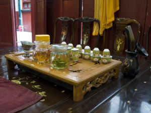 Chinese Tea Set on table in jade Buddha temple, Shanghai by Assaf Frank