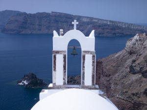 Greece, Cyclades. Santorini Island, Church with mountain in background by Assaf Frank