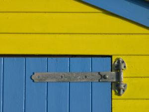 32 Number Sign on Beach hut close-up, Blue Background by Assaf Frank