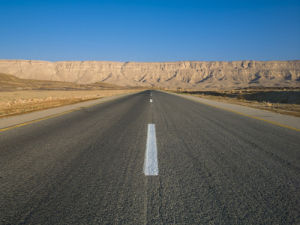 Road with Blue Skies, Vanishing Point, Ramon Crater, Israel by Assaf Frank