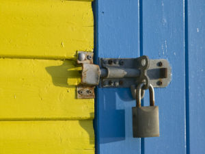 Padlock on beach hut door, Close-up, Littlehampton England by Assaf Frank