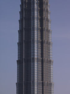 Low angle view of Jinmao tower at dusk, Shanghai by Assaf Frank