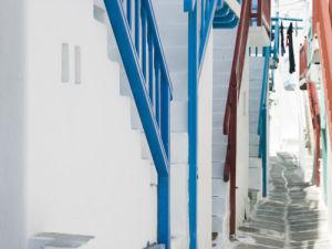 Cobbled street of a town, Mykonos, Cyclades Islands, Greece by Assaf Frank