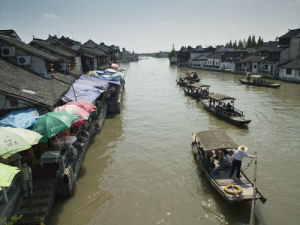 China, Shanghai province, village of Zhujiajiao, tour boats on river by Assaf Frank