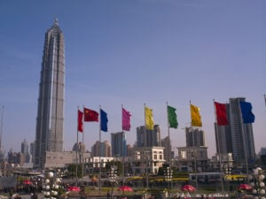 A view of Lujiazui in Shanghai, several colourful flags stands on to show the prosperity of Pudong. by Assaf Frank