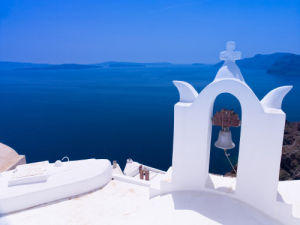 Greece, Cyclades. Santorini Island, Church bell with mountain in background by Assaf Frank