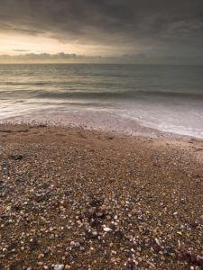 Beach at sunrise, stormy clouds, Littlehumpton England by Assaf Frank