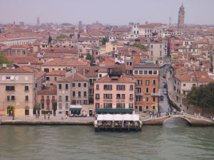 Italy, Venice, houses by canal, aerial view by Assaf Frank