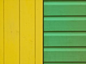 Extreme Close-up of beach hut wall, yellow and green, Littlehampton England by Assaf Frank