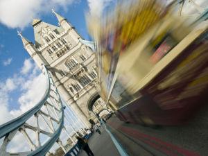 tower bridge london diagonal with bus by Assaf Frank