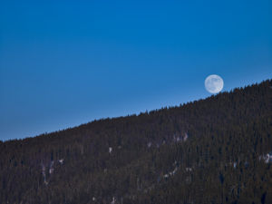 Moon roling down the mountain, France Jura by Assaf Frank