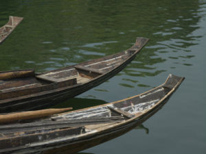 Boat in a row in river, Close-up, Yangtze River by Assaf Frank