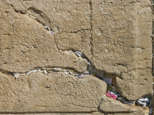 Notes in crevice of Wailing Wall, full frame, Jerusalem, Israel by Assaf Frank