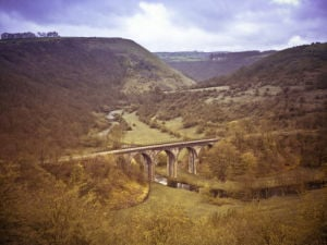 Aerial view of monsal head bridge over river by Assaf Frank