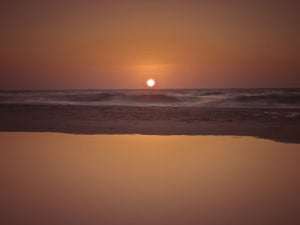 Suntset reflection in water, Palmachim Beach, Israel by Assaf Frank