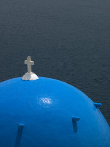 Church dome against sea, Santorini by Assaf Frank