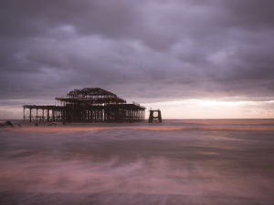 Brighton Pier at dusk by Assaf Frank