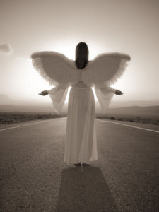 Angel standing on a road at sunrise by Assaf Frank