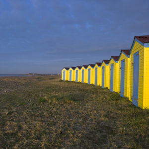 Yellow beach huts, Littlehampton England by Assaf Frank