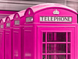England, Close-up of telephone box in a row by Assaf Frank