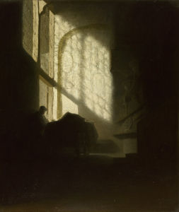 A Man seated reading at a Table in a Lofty Room by Rembrandt