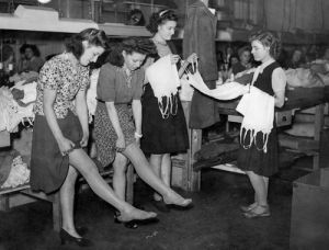 Trying on stockings, 1948 by Mirrorpix