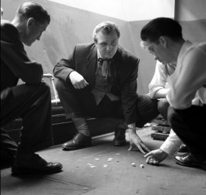 Teddy boy playing dice, 1955 by Mirrorpix