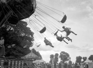 Children on fairground ride, Surbiton 1930 by Mirrorpix