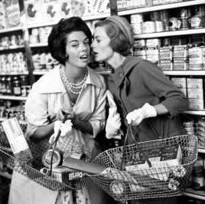 Women whispering in shop, 1960 by Mirrorpix