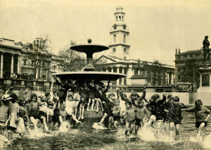 Children in Trafalgar Square fountain, 1920 by Mirrorpix
