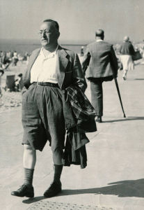 Holidaymaker with raincoat, Clacton 1952 by Mirrorpix