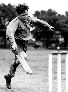 Boy playing cricket, 1946 by Mirrorpix