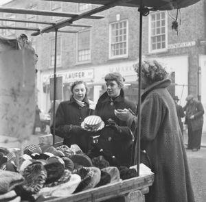 Hat stall, Petticoat Lane 1954 by Mirrorpix
