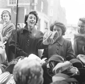 Hat stall, Petticoat Lane 1954 by Mirrorpix