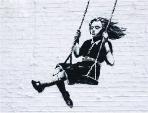 Girl on a Swing by Street Art