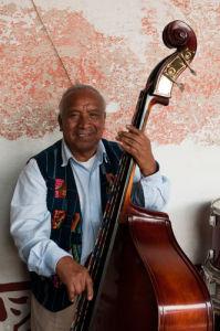 Musician playing Double Bass, Hotel Posada Don Rodrigo, Antigua, Guatemala by Sergio Pitamitz
