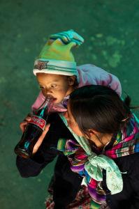 Baby drinking Coca Cola, San Francisco El Alto, Guatemala by Sergio Pitamitz