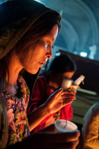 Worshipper, San Francisco church, San Francisco El Alto, Guatemala by Sergio Pitamitz