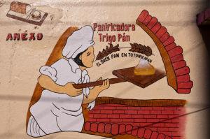 Bakery sign, Totonicapan, Guatemala by Sergio Pitamitz