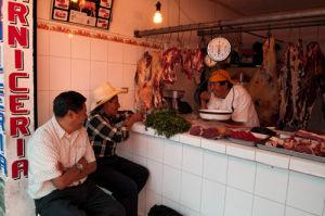 Butcher, Salcaja, Guatemala by Sergio Pitamitz