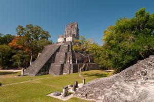 Temple II and Grand Plaza, Tikal mayan archaeological site, Guatemala by Sergio Pitamitz