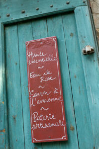 Sign outside food shop, Moustiers-Sainte-Marie, Provence, France by Sergio Pitamitz
