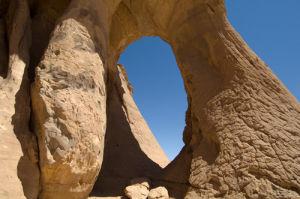 Tin Ghalega rock formation, Red Rhino Arch, Wadi Teshuinat, Akakus, Sahara desert, Fezzan, Libya by Sergio Pitamitz
