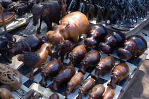 Carvings in souvenir shop, Victoria Falls, Zambesi River, Zambia by Sergio Pitamitz